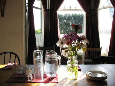 At the breakfast table on a summer morning